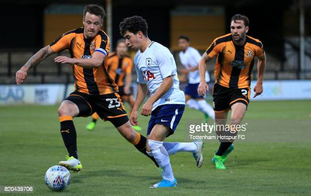 Samuel Shashowa of Tottenham Hotspur and Josh Coulson of Cambridge United compete for the ball during the pre season friendly match between Cambridge...
