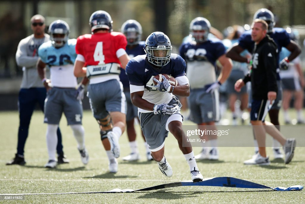 Samuel Stewart runs with the ball during a Rice University College Football training session at David Phillips Sports Complex on August 24, 2017 in Sydney, Australia.
