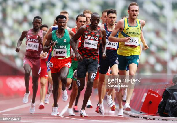 Samuel Tefera of Team Ethiopia, Timothy Cheruiyot of Team Kenya and Oliver Hoare of Team Australia compete in round one of the Men's 1500m heats on...