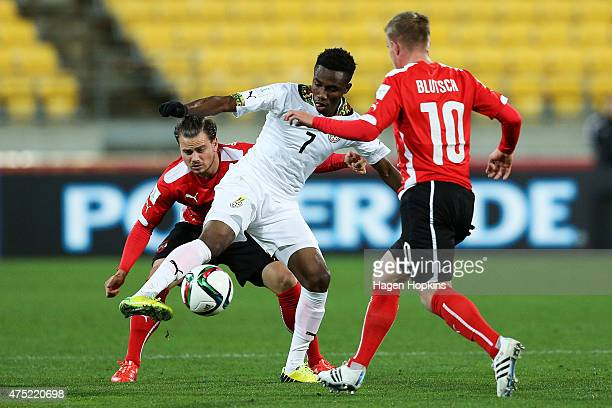 Samuel Tetteh of Ghana controls the ball under pressure from Daniel Rosenbichler and Markus Blutsch of Austria during the Group B FIFA U20 World Cup...