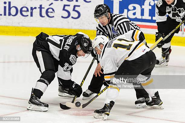 Samuel Tremblay of the BlainvilleBoisbriand Armada and Clark Bishop of the Cape Breton Screaming Eagles take a faceoff during the QMJHL game at the...