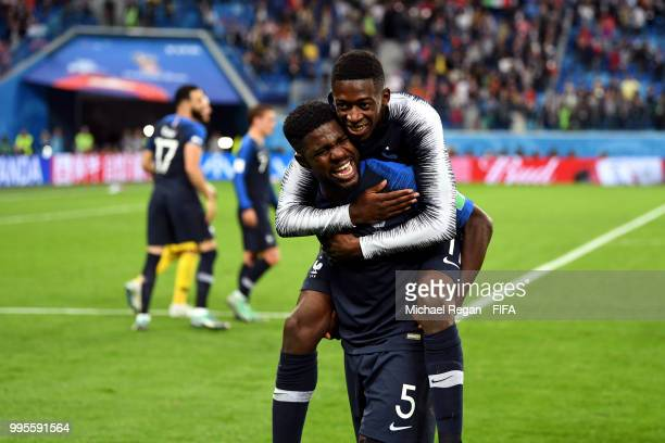 Samuel Umtiti and Ousmane Dembele of France celebrate victory following the 2018 FIFA World Cup Russia Semi Final match between Belgium and France at...