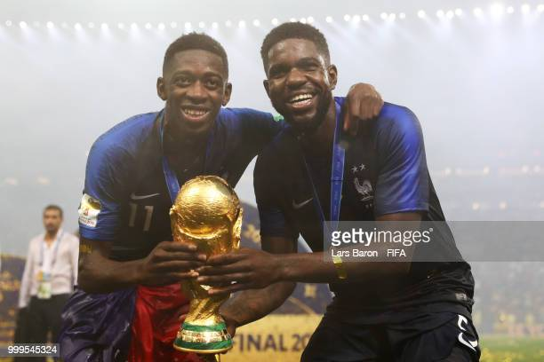 Samuel Umtiti and Ousmane Dembele of France celebrate victory following the 2018 FIFA World Cup Final between France and Croatia at Luzhniki Stadium...