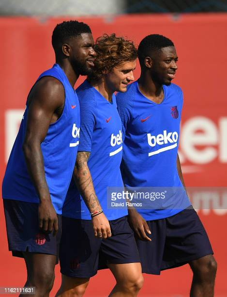 Samuel Umtiti, Antoine Griezmann and Ousmane Dembele of FC Barcelona arrive at their first training session at Ciutat Esportiva of Sant Joan Despi on...