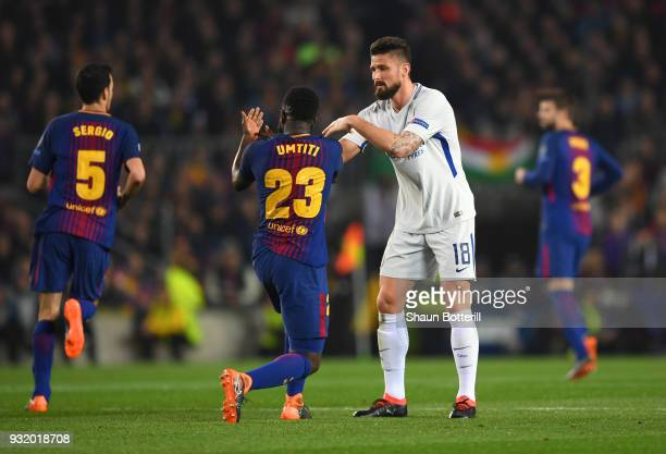 Samuel Umtiti of Barcelona and Olivier Giroud of Chelsea clash during the UEFA Champions League Round of 16 Second Leg match FC Barcelona and Chelsea...
