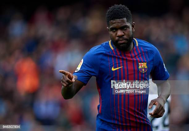 Samuel Umtiti of Barcelona celebrates after scoring the second goal during the La Liga match between Barcelona and Valencia at Camp Nou on April 14...