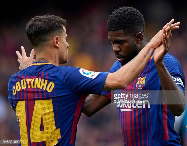 Samuel Umtiti of Barcelona celebrates with Philippe Coutinho after scoring the second goal during the La Liga match between Barcelona and Valencia at...