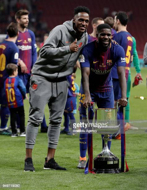 Samuel Umtiti of Barcelona celebrates with the trophy after Copa del Rey Final soccer match between Sevilla and Barcelona at Wanda Metropolitano...