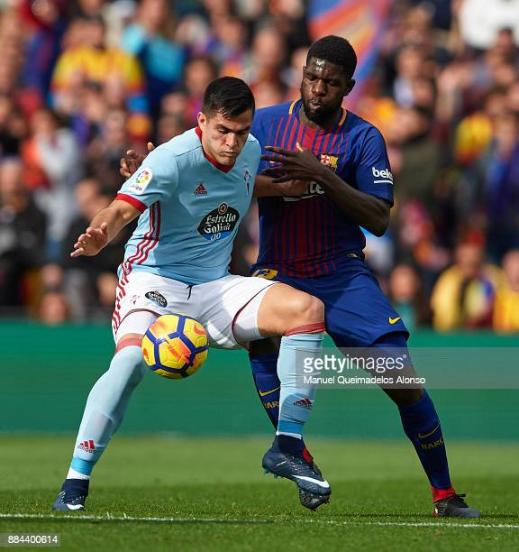 Samuel Umtiti of Barcelona competes for the ball with Maxi Gomez of Celta during the La Liga match between Barcelona and Celta de Vigo at Camp Nou on...