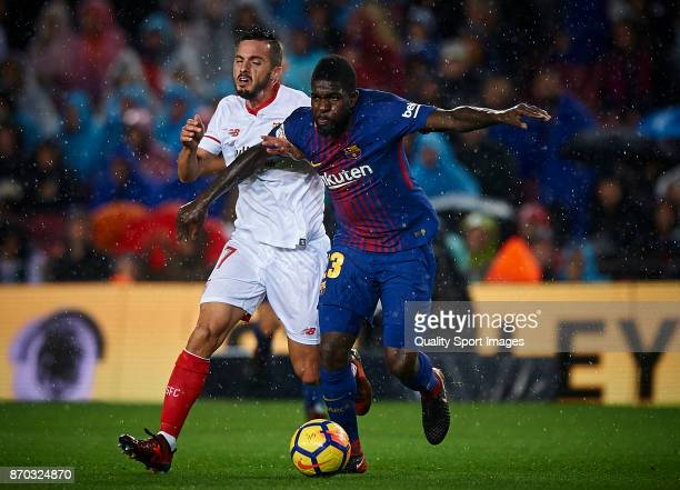 Samuel Umtiti of Barcelona competes for the ball with Pablo Sarabia of Sevilla during the La Liga match between Barcelona and Sevilla at Camp Nou on...