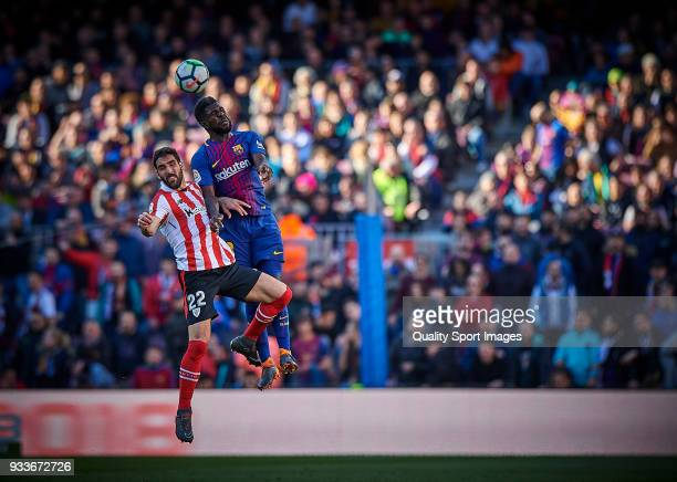 Samuel Umtiti of Barcelona competes for the ball with Raul Garcia of Athletic Club during the La Liga match between Barcelona and Athletic Club at...