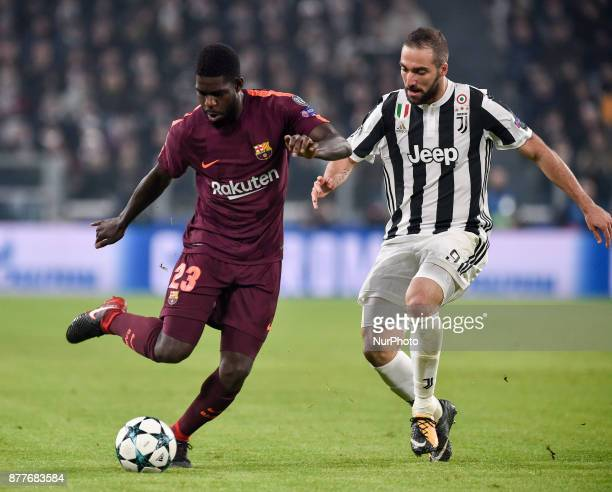 Samuel Umtiti of Barcelona is challenged by Gonzalo Higuan of Juventus during the UEFA Champions League match between Juventus and Barcelona at the...