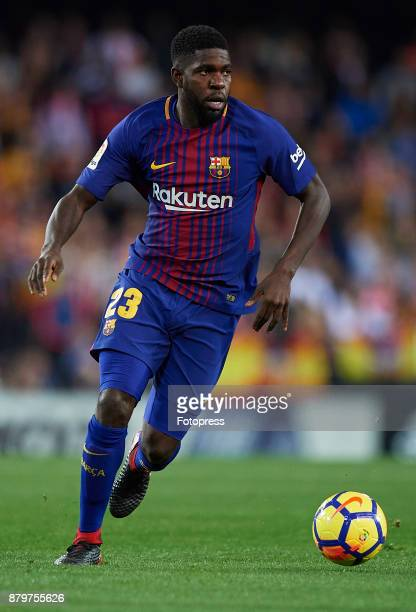 Samuel Umtiti of Barcelona runs with the ball during the La Liga match between Valencia and Barcelona at Estadio Mestalla on November 26 2017 in...