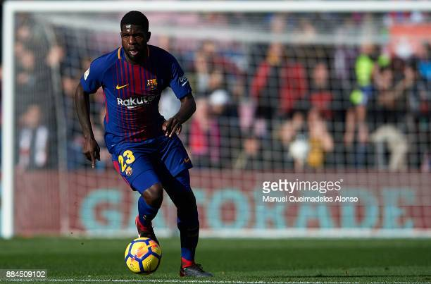 Samuel Umtiti of Barcelona runs with the ball during the La Liga match between Barcelona and Celta de Vigo at Camp Nou on December 2 2017 in...