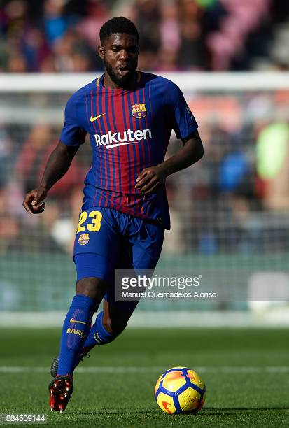 Samuel Umtiti of Barcelona runs with the ball during the La Liga match between Barcelona and Celta de Vigo at Camp Nou on December 2 2017 in...