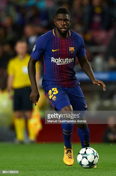 Samuel Umtiti of Barcelona runs with the ball during the UEFA Champions League group D match between FC Barcelona and Olympiakos Piraeus at Camp Nou...