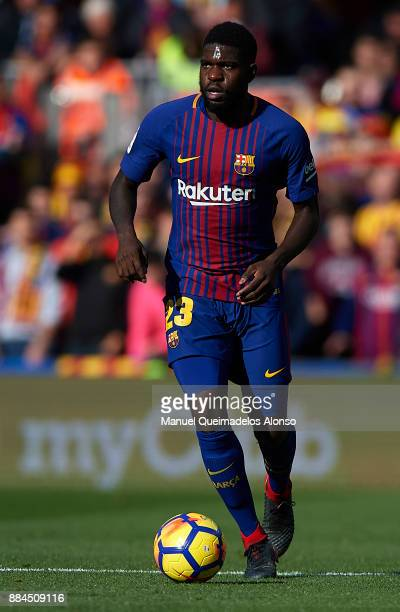 Samuel Umtiti of Barcelona runs with the ballnduring the La Liga match between Barcelona and Celta de Vigo at Camp Nou on December 2 2017 in...