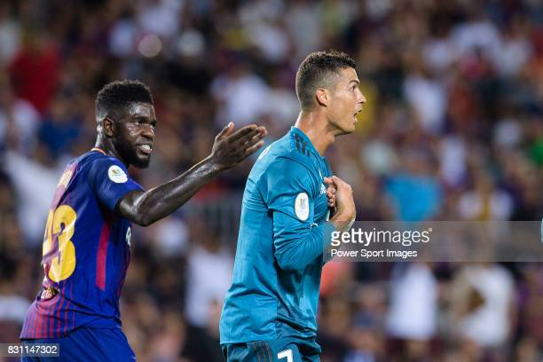 Samuel Umtiti of FC Barcelona and Cristiano Ronaldo of Real Madrid who gestures after gets a red card during the Supercopa de Espana Final 1st Leg...