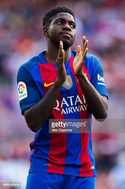 Samuel Umtiti of FC Barcelona applauds during the team official presentation ahead of the Joan Gamper trophy match between FC Barcelona and UC...