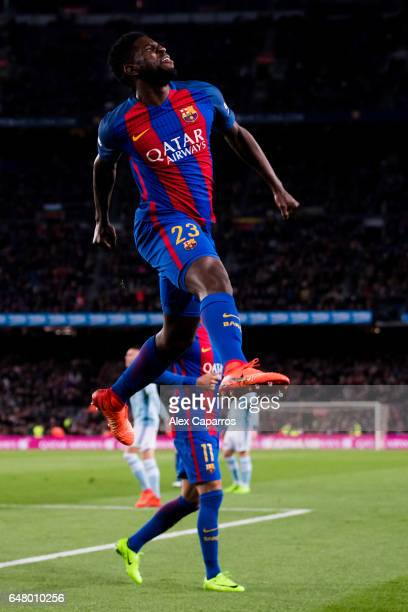 Samuel Umtiti of FC Barcelona celebrates after scoring his team's fourth goal during the La Liga match between FC Barcelona and RC Celta de Vigo at...
