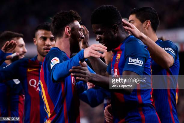 Samuel Umtiti of FC Barcelona celebrates with his teammate Lionel Messi after scoring his team's fourth goal during the La Liga match between FC...