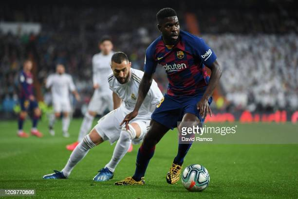 Samuel Umtiti of FC Barcelona competes for the ball with Karim Benzema of Real Madrid CF during the Liga match between Real Madrid CF and FC...