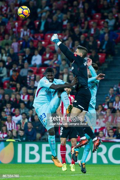 Samuel Umtiti of FC Barcelona competes for the ball with Kepa Arrizabalaga of Athletic Club during the La Liga match between Athletic Club Bilbao and...