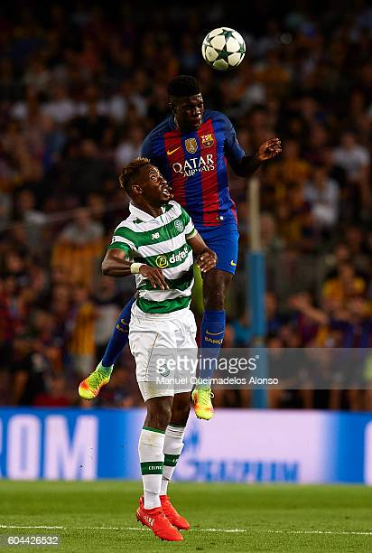 Samuel Umtiti of FC Barcelona competes for the ball with Moussa Dembele of Celtic FC during the UEFA Champions League Group C match between FC...