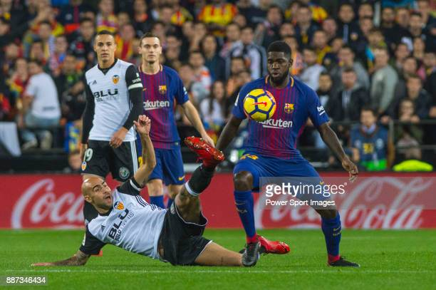 Samuel Umtiti of FC Barcelona competes for the ball with Rodrigo Moreno of Valencia CF during the La Liga 201718 match between Valencia CF and FC...