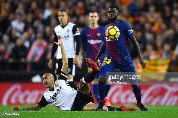 Samuel Umtiti of FC Barcelona competes for the ball with Simone Zaza of Valencia CF during the La Liga match between Valencia and Barcelona at...