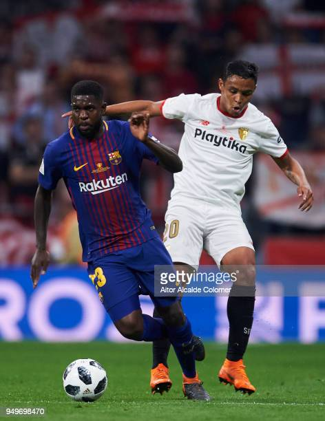 Samuel Umtiti of FC Barcelona duels for the ball with Luis Muriel of Sevilla FC during the Spanish Copa del Rey Final between Barcelona and Sevilla...