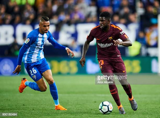 Samuel Umtiti of FC Barcelona duels for the ball with Youssef EnNesyri of Malaga during the La Liga match between Malaga and Barcelona at Estadio La...