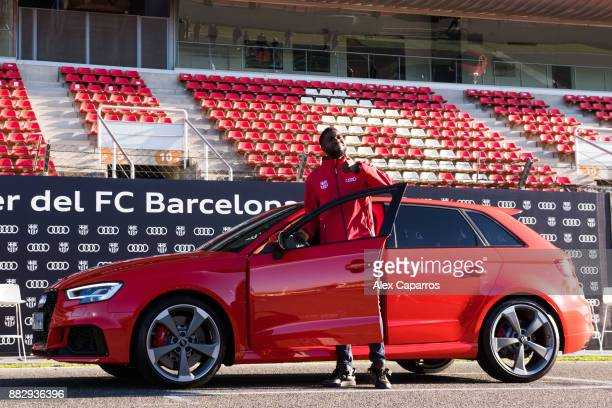 Samuel Umtiti of FC Barcelona is presented with his new Audi car during the Audi Car handover to the players of FC Barcelona on November 30 2017 at...