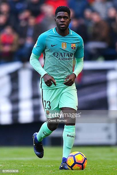 Samuel Umtiti of FC Barcelona runs with the ball during the La Liga match between CA Osasuna and FC Barcelona at Sadar stadium on December 10 2016 in...
