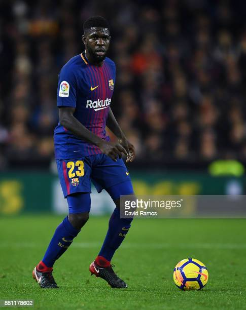 Samuel Umtiti of FC Barcelona runs with the ball during the La Liga match between Valencia and Barcelona at Mestalla stadium on November 26 2017 in...