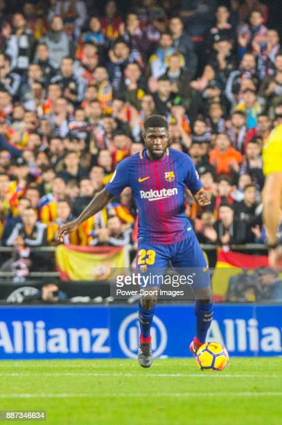 Samuel Umtiti of FC Barcelona runs with the ball during the La Liga 201718 match between Valencia CF and FC Barcelona at Estadio de Mestalla on...