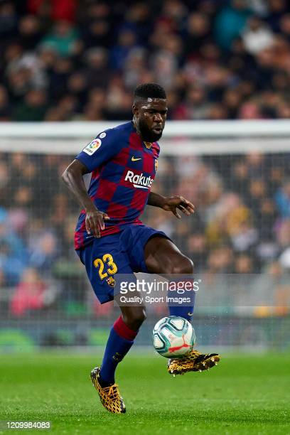 Samuel Umtiti of FC Barcelona runs with the ball during the Liga match between Real Madrid CF and FC Barcelona at Estadio Santiago Bernabeu on March...
