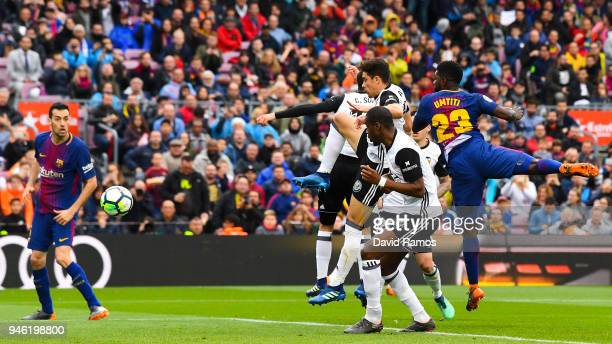 Samuel Umtiti of FC Barcelona scores his team's second goal during the La Liga match between Barcelona and Valencia at Camp Nou on April 14 2018 in...