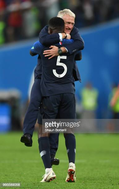 Samuel Umtiti of France and Didier Deschamps Manager of France celebrate following their sides victory in the 2018 FIFA World Cup Russia Semi Final...