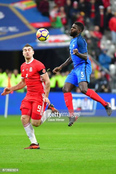 Samuel Umtiti of France and Sam Vokes of Wales during the international friendly match between France and Wales at Stade de France on November 10...