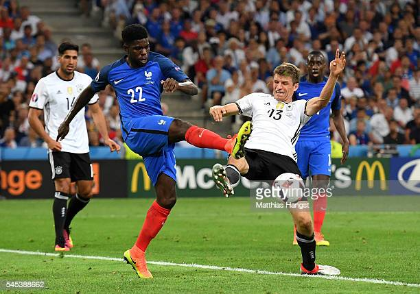 Samuel Umtiti of France and Thomas Mueller of Germany compete for the ball during the UEFA EURO semi final match between Germany and France at Stade...