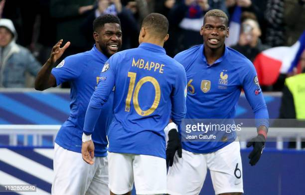 Samuel Umtiti of France celebrates his goal with Kylian Mbappe Paul Pogba and teammates during the 2020 UEFA European Championships group H...