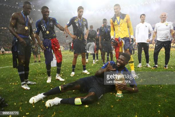 Samuel Umtiti of France celebrates victory with the World Cup trophy following the 2018 FIFA World Cup Final between France and Croatia at Luzhniki...