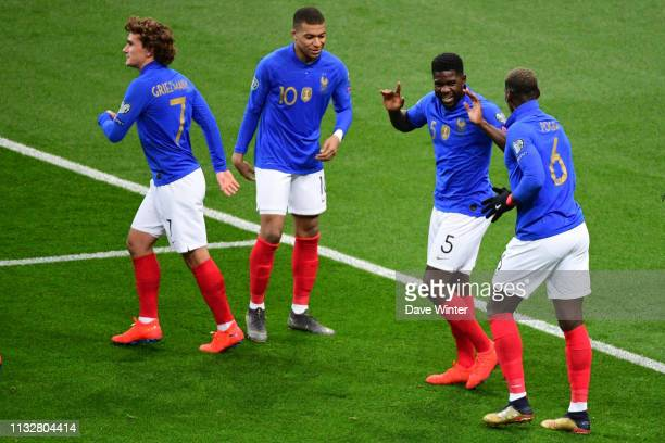 Samuel Umtiti of France celebrates with Paul Pogba of France after putting his side 10 during the European Championship 2020 qualifying match between...