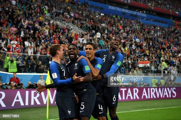 Samuel Umtiti of France celebrates with team mates after scoring his team's first goal during the 2018 FIFA World Cup Russia Semi Final match between...