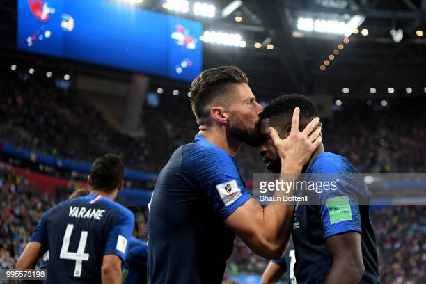Samuel Umtiti of France celebrates with teammate Olivier Giroud after scoring his team's first goal during the 2018 FIFA World Cup Russia Semi Final...