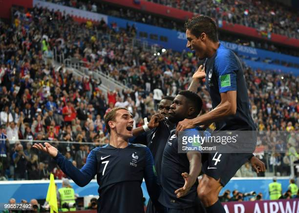 Samuel Umtiti of France celebrates with teammates after scoring his team's first goal during the 2018 FIFA World Cup Russia Semi Final match between...