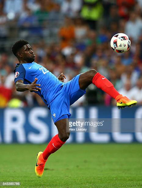Samuel Umtiti of France clears the ball during the UEFA EURO semi final match between Germany and France at Stade Velodrome on July 7 2016 in...