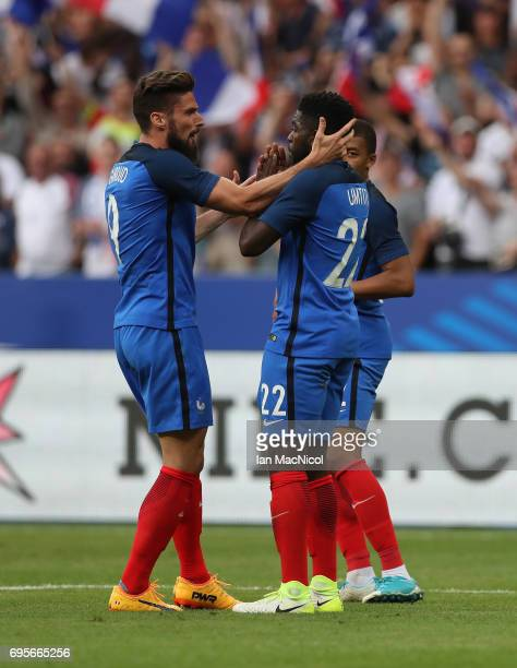 Samuel Umtiti of France is congratulated on scoring by Olivier Giroud of France during the international Friendly match between France and England at...
