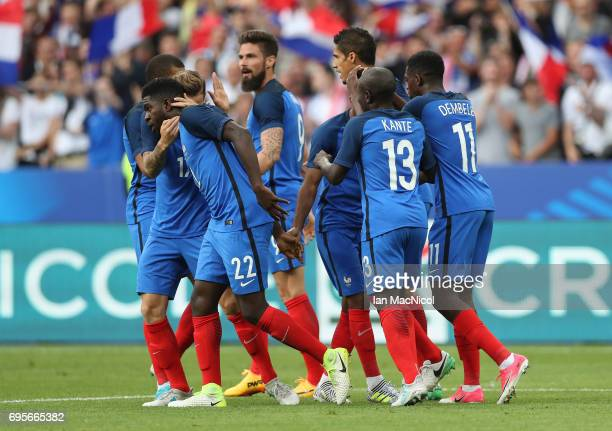 Samuel Umtiti of France is congratulated on scoring by team mates during the international Friendly match between France and England at Stade de...